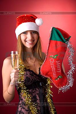 Junge Frau mit Weihnachtsstrumpf | Foto mit hoher Auflösung |ID 3022438