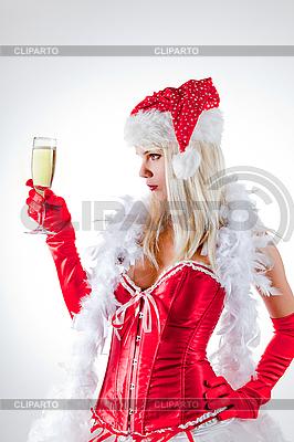 Мисс Санта смотрит на бокал шампанского | Фото большого размера |ID 3023520