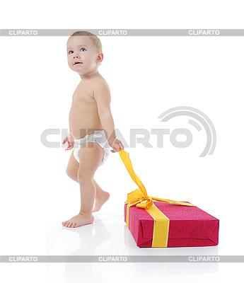 Szczęśliwe dziecko z prezentem | Foto stockowe wysokiej rozdzielczości |ID 3021643