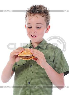 Mały chłopiec jedzenia hamburger | Foto stockowe wysokiej rozdzielczości |ID 3021927