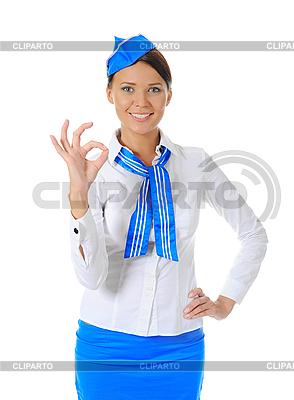 Attraktive Stewardess zeigt Okay | Foto mit hoher Auflösung |ID 3021995
