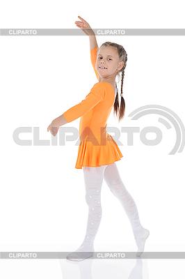 Kleine Ballerina tanzt im orangefarbenen Kleid. | Foto mit hoher Auflösung |ID 3022026