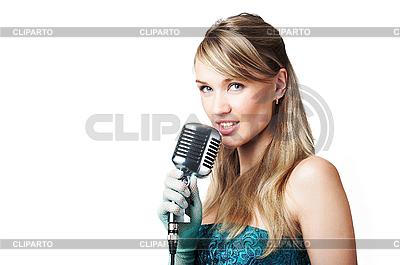 Hübsches Mädchen singend in Retro-Mikrofon | Foto mit hoher Auflösung |ID 3024221