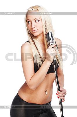 Sexy Sängerin hält Retro-Mikrofon | Foto mit hoher Auflösung |ID 3032461