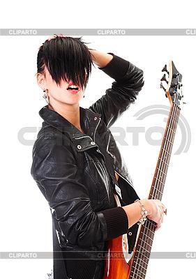 Punk-Mädchen mit einer Gitarre singt | Foto mit hoher Auflösung |ID 3032471