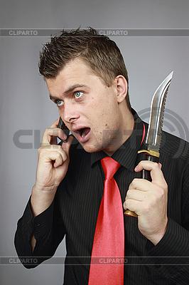 Mężczyzna rozmawia przez telefon komórkowy | Foto stockowe wysokiej rozdzielczości |ID 3059897