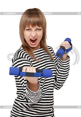 Młoda dziewczyna z hantle krzyczy | Foto stockowe wysokiej rozdzielczości |ID 3050727