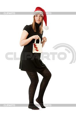 Красивая девушка в красной шапке Санта-Клауса | Фото большого размера |ID 3066382