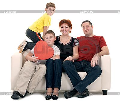Familie von vier Personen auf einem Sofa | Foto mit hoher Auflösung |ID 3067168