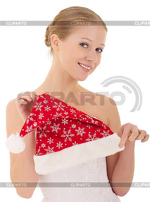 Piękne dziewczyny gospodarstwa Christmas hat | Foto stockowe wysokiej rozdzielczości |ID 3123326