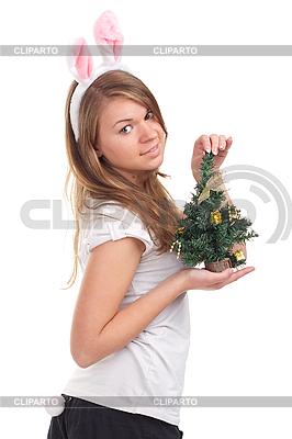 女孩打扮成兔子的圣诞树在手中 | 高分辨率照片 |ID 3092641