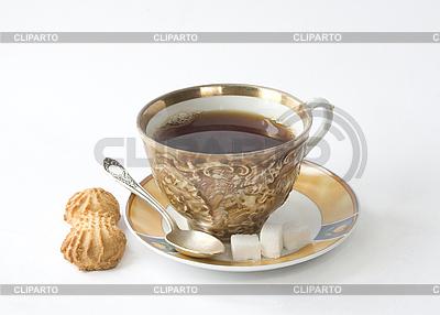 Filiżanka herbaty na spodek z cukru i pieczenia | Foto stockowe wysokiej rozdzielczości |ID 3121672