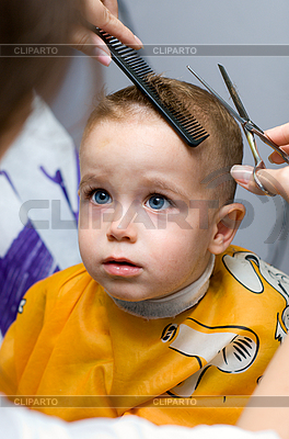 Haircutting one year old boy in the hairdressing saloon - © kzenia