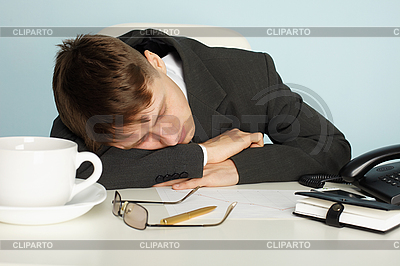 Office worker was tired and fell asleep at table | Foto stockowe wysokiej rozdzielczości |ID 3145545