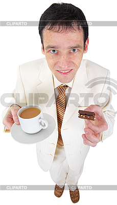 3152545-funny-young-man-drinking-coffee-with-sweets.jpg