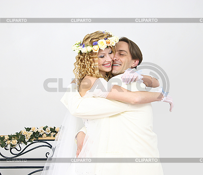 Young couple posing in a studio on the wedding day NickNick
