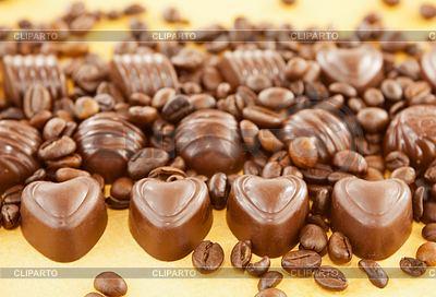 http://img.cliparto.com/pic/xl/190098/3223998-heart-shaped-chocolate-candies-and-coffee-beans.jpg