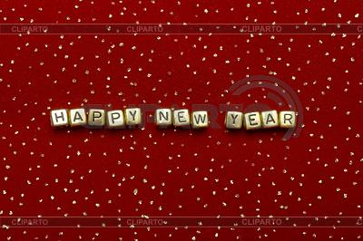 Zwrot szczęśliwego nowego roku z perełek na czerwonym aksamicie | Foto stockowe wysokiej rozdzielczości |ID 3299494