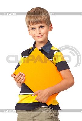 Uczeń trzyma książkę | Foto stockowe wysokiej rozdzielczości |ID 3383868