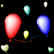 colored balloons over black background
