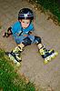 Der Junge mit Rollschuhen | Stock Foto