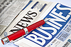 Red pen on the business newspaper | Stock Foto