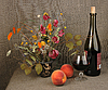 Two orange peaches, bouquet and red wine | Stock Foto