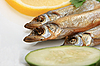 Smoked fishes with lemon, cucumber and green parsley | Stock Foto