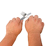 Two thick hands with knife and fork | Stock Foto
