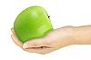 Green apple in hand    Stock Foto