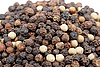 Heap of black and white pepper | Stock Foto