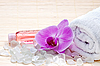 Pink orchid, white towels and bath salts. Spa set | Stock Foto