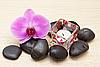 ID 3014415 | Różowa orchidea i zen kamienie z świeca | Foto stockowe wysokiej rozdzielczości | KLIPARTO