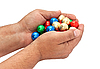Shiny balls in the men`s hands. | Stock Foto