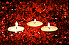 Lighted candles on red | Stock Foto