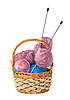 Yarn for knitting with knitting needles in wicker basket | Stock Foto