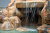 Photo 300 DPI: artificial grotto with waterfall