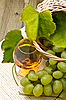 White grapes in basket and glass of wine | Stock Foto