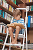 Boy in library reading book | Stock Foto
