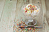 Ice cream with the sugar chips on wooden table | Stock Foto