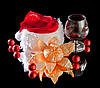 Glasses of wine, tangerine and red Christmas hat | Stock Foto