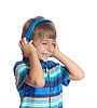 Boy listens to music on headphones | Stock Foto