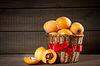 Loquats in basket on wooden background | 免版税照片