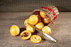 Loquats in basket on wooden background. Vintage | 免版税照片