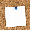 Photo 300 DPI: White note pinned to cork board close up