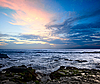 Rocky ocean coast on sunset | Stock Foto