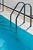 Ladder to swimming pool   Stock Foto