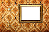 Photo 300 DPI: Vintage gold plated picture frame on retro wallpaper