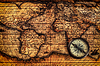 Old vintage compass on ancient map | Stock Foto