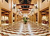 Photo 300 DPI: Huge hall interior in golden colors